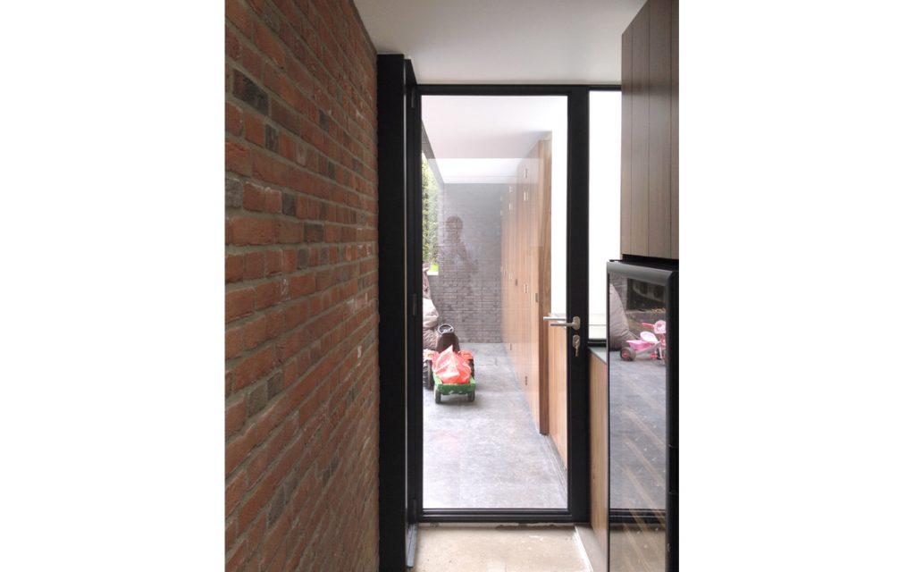 architectuur uitbouw doorzicht deur glas