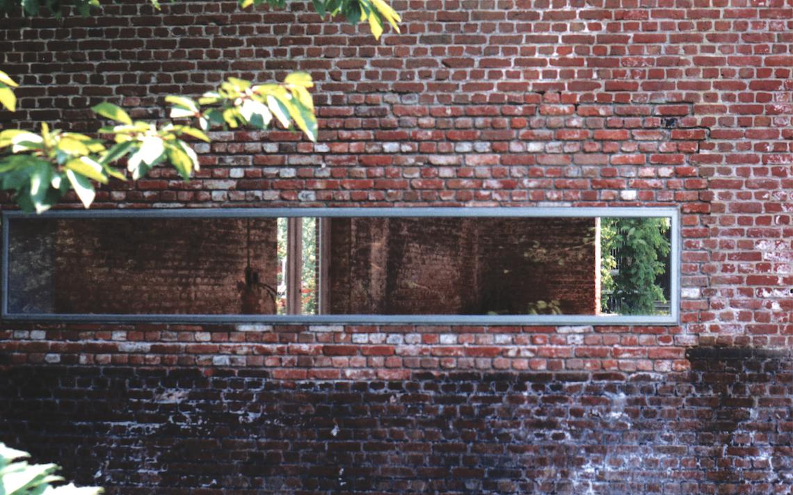loft lintvenster in oudee baksteen