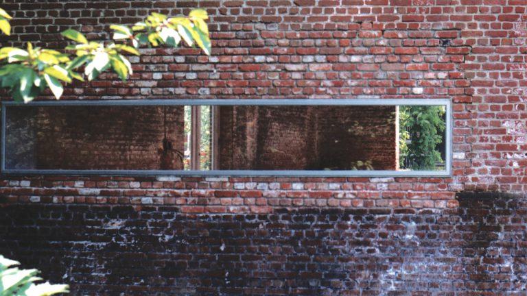 Rekem lintvenster in historisch baksteen